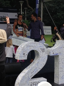 Eloise receiving her prize for winning the SMH Half Marathon.